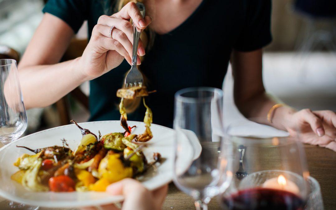 Woman eating at restaurant stock image